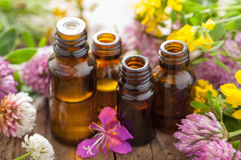Natural Oils Surrounded by a Flower Garden