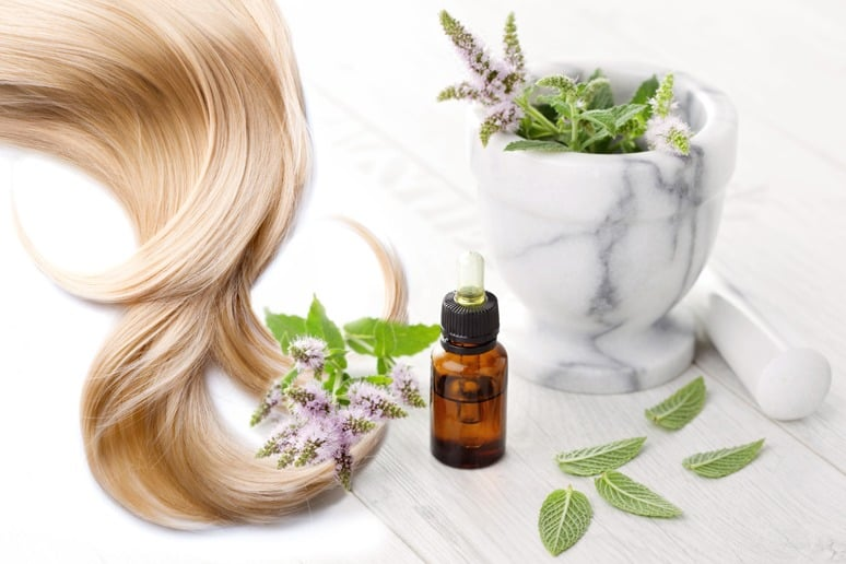 Essential Oil Surrounded By Long Blonde Flowing Hair