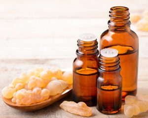 rankincense essential oil and frankincense on the table