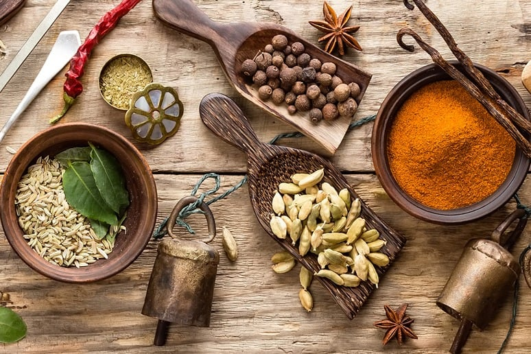 Ayurveda and other ingredients on a wooden table
