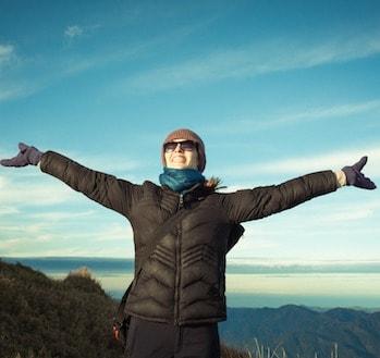 Cheering woman hiker