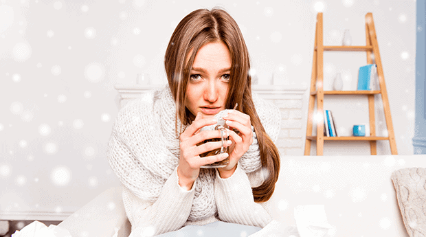 Woman in White Sick With Cold Holds Hot Drink