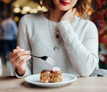woman eating food with high glycemic index