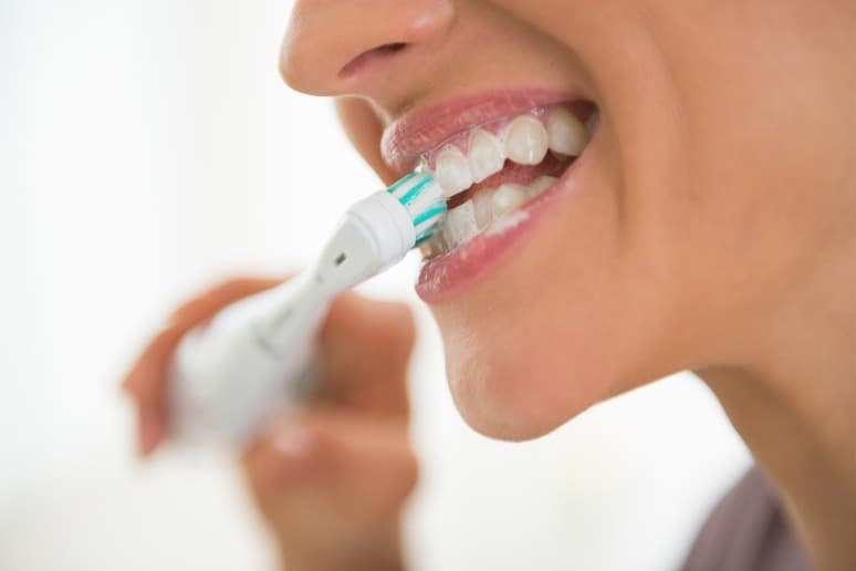 Woman Brushes Her Teeth with Her Own Homemade Organic Toothpaste
