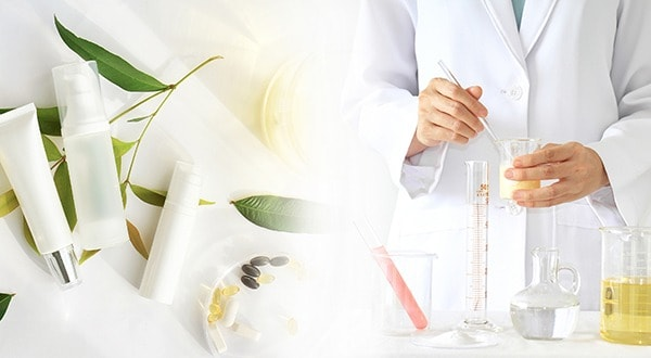 Scientist Mixing Essential Oils