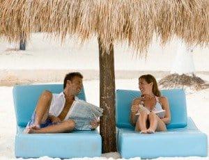 couple at beach under umbrella