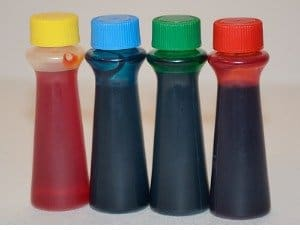 four bottles of food coloring