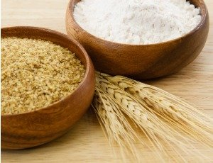 bowls of wheat flour and wheat germ