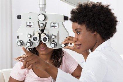 optometrist giving patient eyesight exam